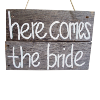 Wooden 'Here Comes the Bride' sign.