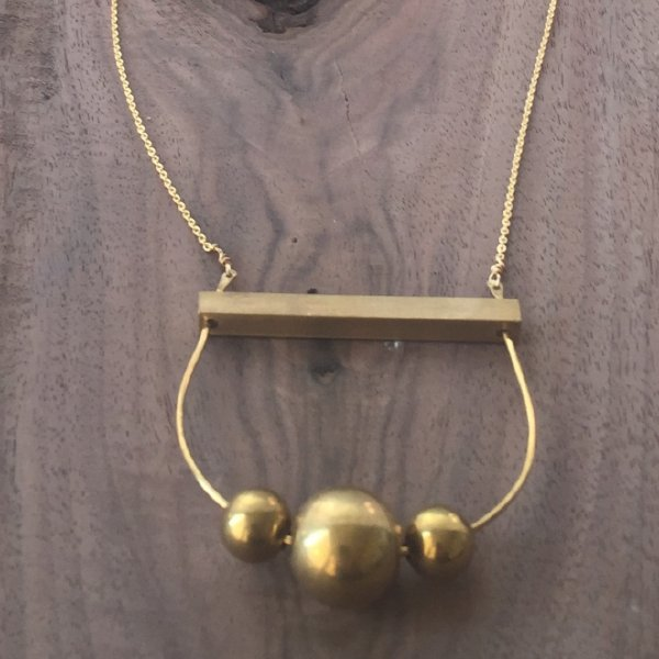 Gia Brass Sphere Arch Necklace
