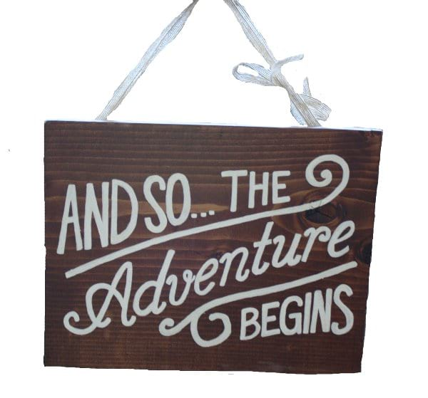 Adventure Begins Sign