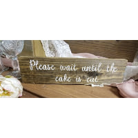 Sign - Please wait until the cake is cut