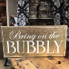 S527 bring on the bubbly sign