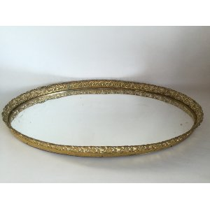 large gold mirrored tray
