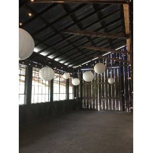 Extra globe lighting for barn with paper lanterns