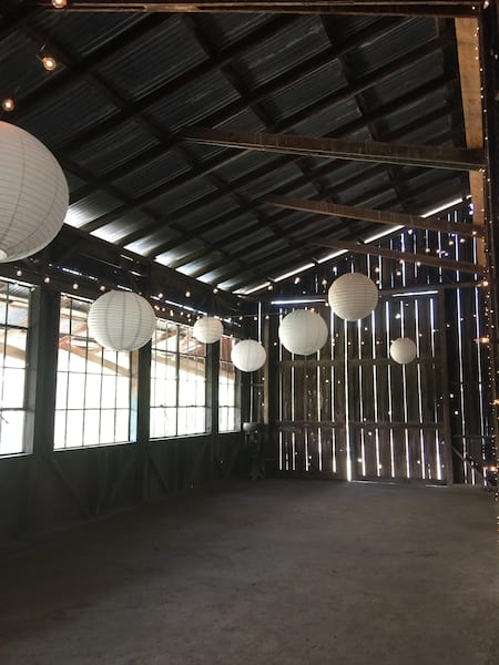 Hanging Paper Lanterns in the Barn