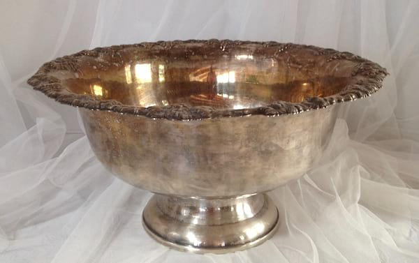 large silver bowl with decorated edge