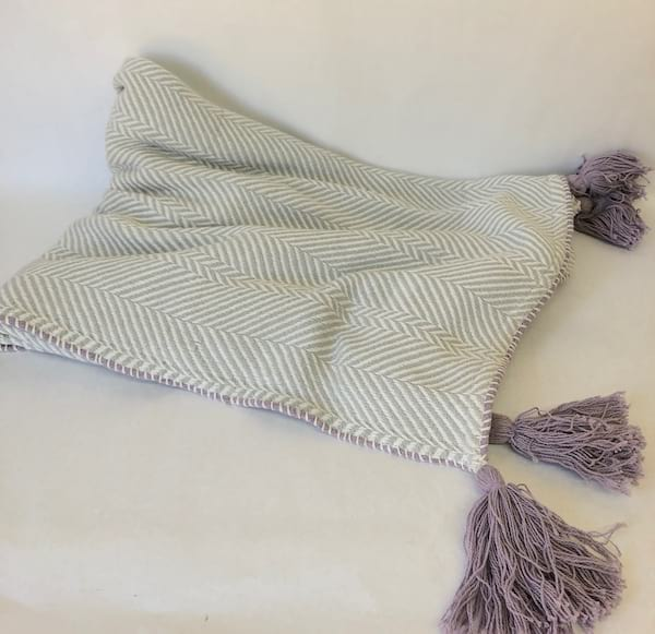 Gray throw with lavender trim