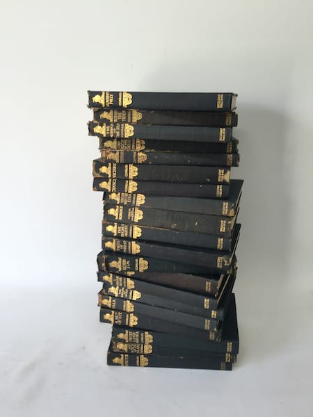 VINTAGE BLACK AND GOLD BOOK