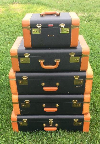 Stack of 5: Black & Tan Vintage Luggage