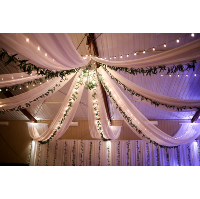 white ceiling drapery with greenery