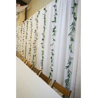 Illuminated backdrop with greenery