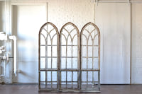 Trio of Arched Windows with Risers