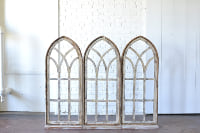 Trio of Arched Windows with Stands