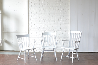 Mismatched White Wooden Armchairs