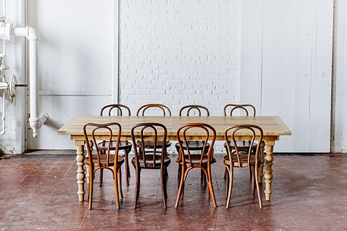 custom wooden table with vintage mismatched collection of bentwood chairs