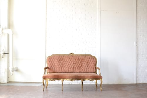 pink peach vintage velvet sofa gold detail on white backround