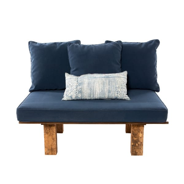 rustic wood settee with pink or navy cushions