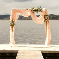 Double Swoop Fabric Arch Setup. Flowers not included, but can be quoted on.
