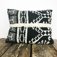 Black and white fringed pillow