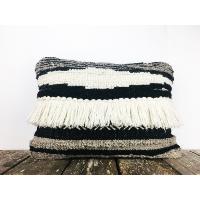 Black and white tasseled pillow