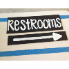RESTROOM - CHALKBOARD SIGN ON WOOD STAKE