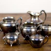 silver creamers/sugar bowls
