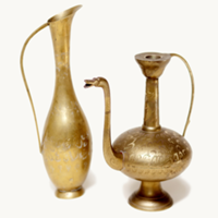 large brass pitchers