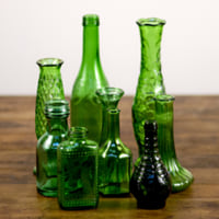 assorted green glass vases