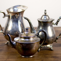 silver pitchers and teapots