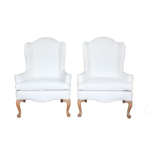 The Lorraines: Cream Wingback Chairs