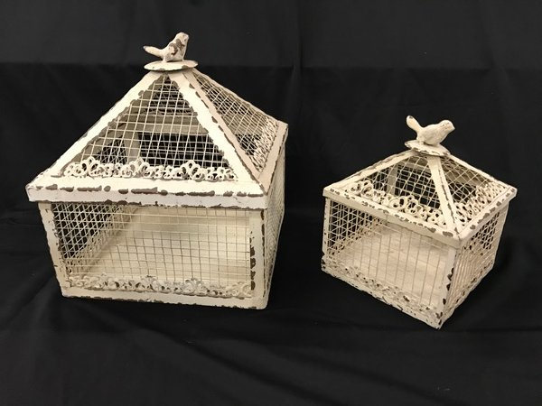 Set of two ivory cages