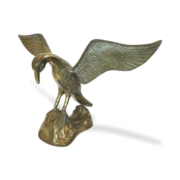 Brass Duck on Rock
