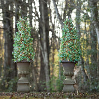 faux topiary in pedestal urn