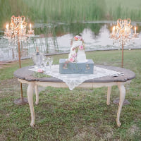french table with dark top & cream legs