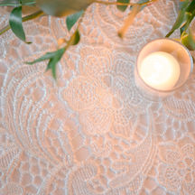 English lace overlay on white tablecloth.