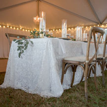 English lace overlay inside tent for wedding reception.