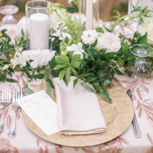 Floral gold charger with blush napkins at wedding reception.  Photo by Jenna Lindsey.