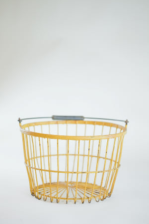yellow coated metal egg basket
