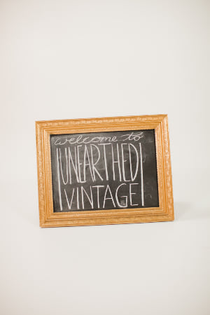 small gold ornate chalkboard