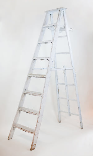 8' white wooden A-frame ladder