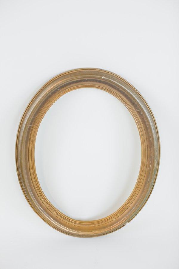 oval brass frame