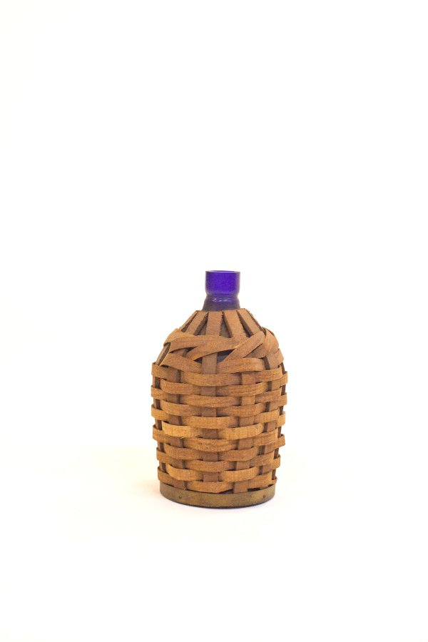wicker covered bottle