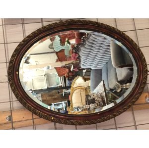 Oval timber and gold mirror